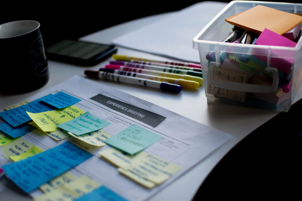 markers, post its and various plans on the desk