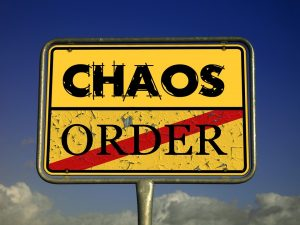 A sign with the words chaos and order