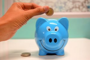 Blue piggy bank you'll need for all the money you save after you realize why hiring long distance movers San Antonio is an excellent idea
